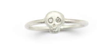 Dainty silver ring with skull on it