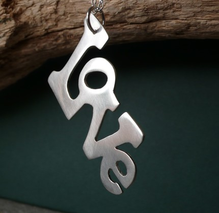 Typographic silver pendant featuring the word LOVE