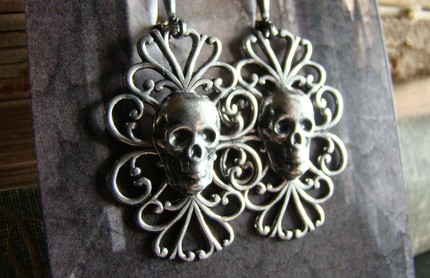 Filigree drop earrings with skulls
