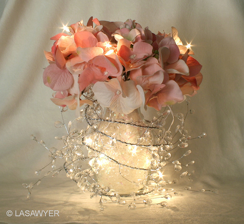Table centrepiece, vase with hydrangeas and fairy lights