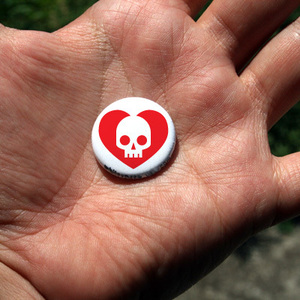 Button badge with heart skull