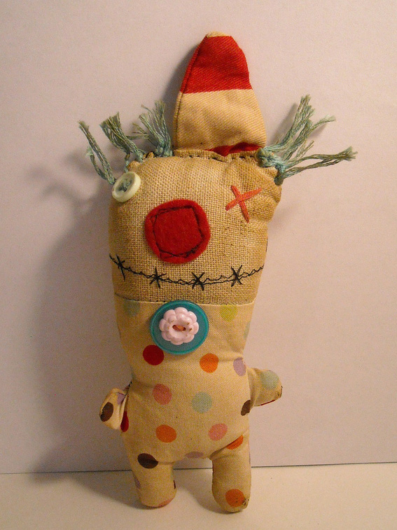 Junker Jane sewn monster-like doll—happy sappy clown