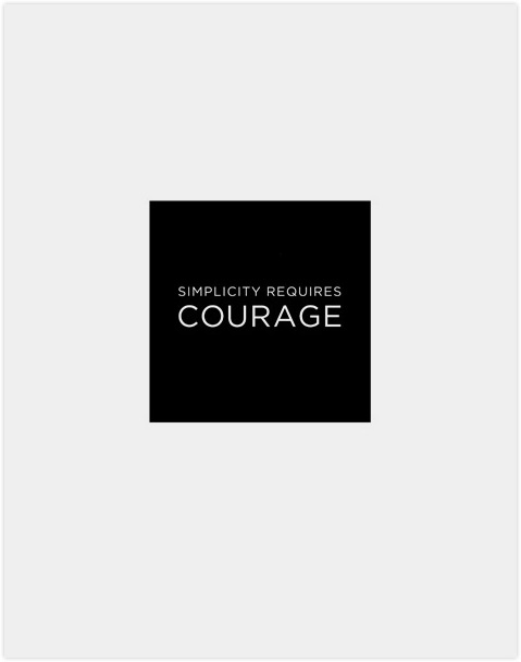 "Clean white type in black square in white space. Says ""Simplicity requires courage""."
