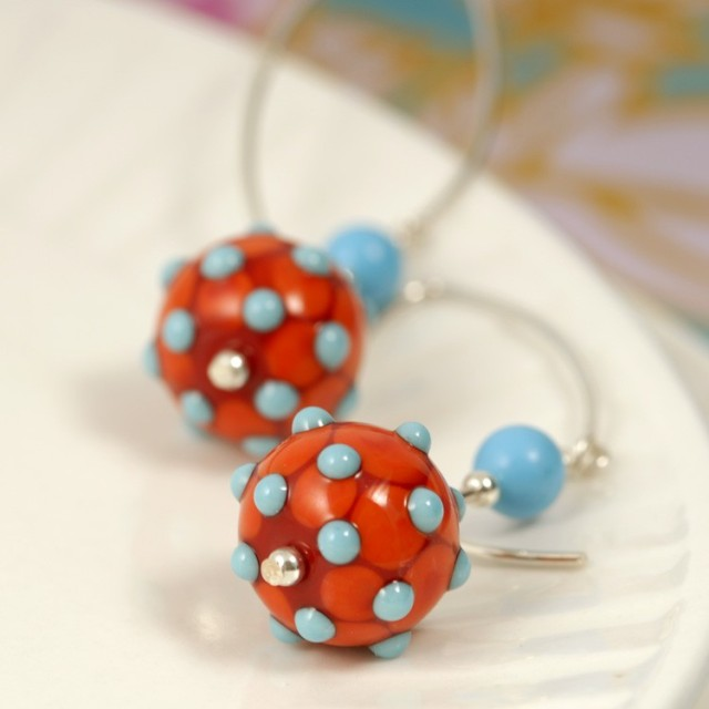 Handmade glass beads, closeup of drop-style earrings