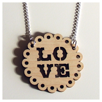 Necklace with maple disc with the word LOVE burned through it