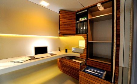 Interior of OfficePod—neat, clean, modern, some wood panelling but nice, not nasty