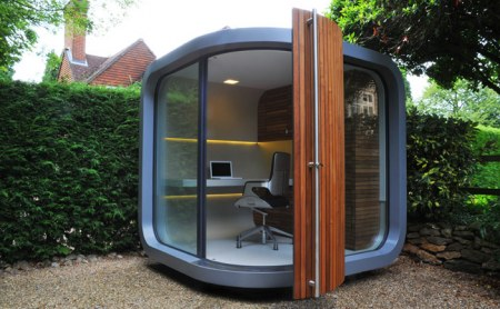 Exterior of OfficePod—cube in garden with big glass walls on two sides