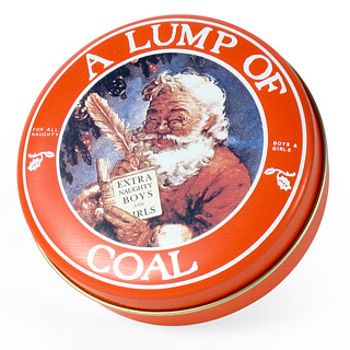 Decorative tin with a lump of coal in it