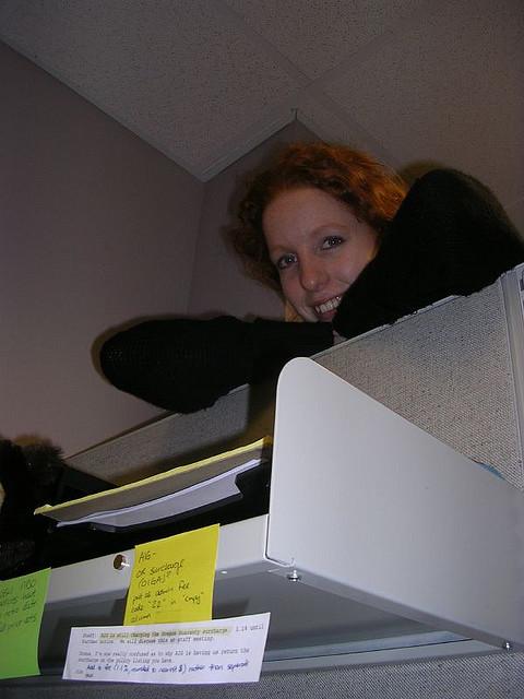 peeking over cubicle wall