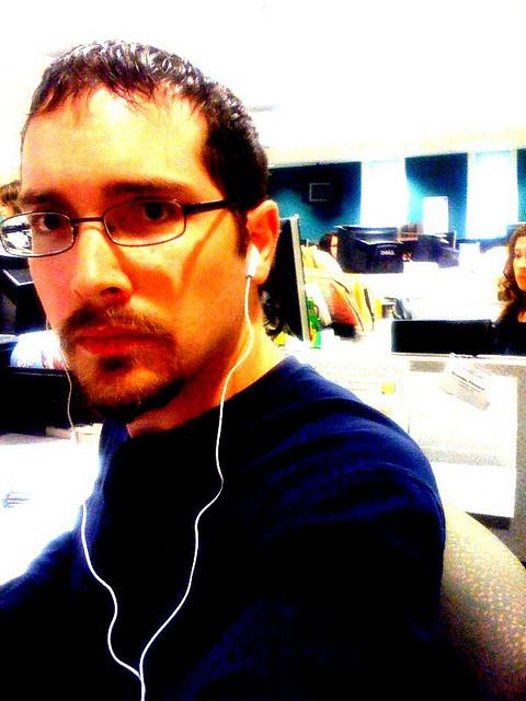guy at work wearing headphones