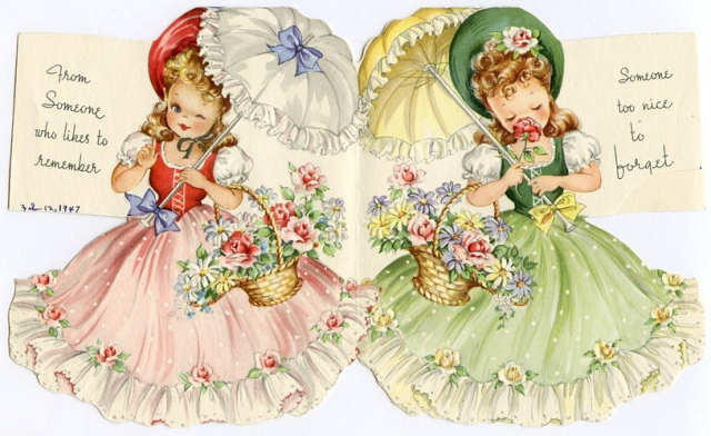 Inside of old greeting card, girls with parasols and big flowing skirts