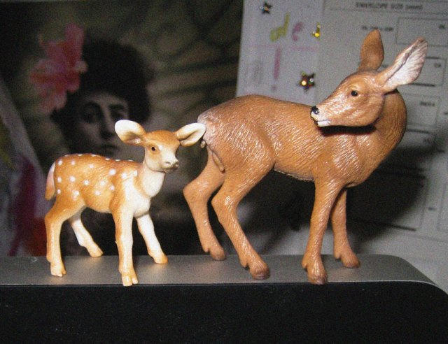 The two cute plastic deer that sit on top of my computer