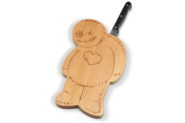 Voodoo cutting board with knife stuck in it