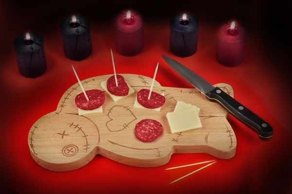 Voodoo cutting board covered in salami