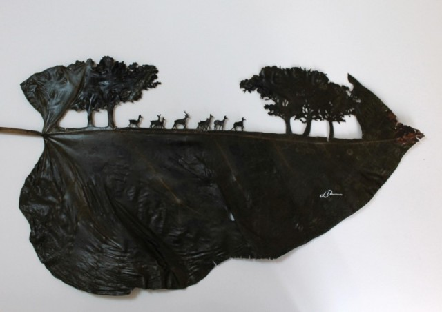 Lorenzo Duran leaf cut art - landscape with trees and deer in silhouette