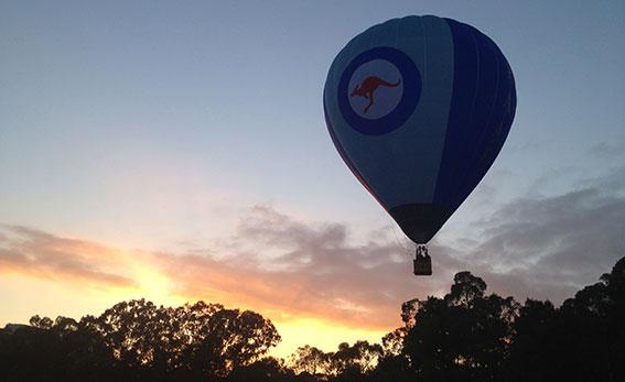 Balloon against a pink sunrise