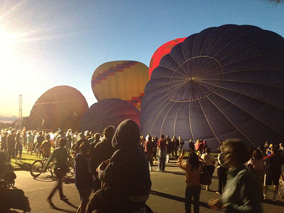 Baloons on the ground being inflated